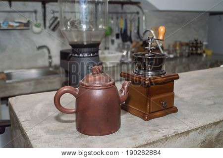 vintage grinder with roasted coffee beans and grind coffee