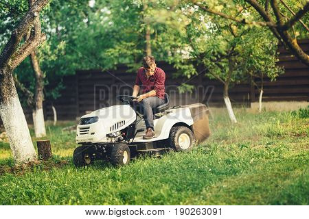 Professional Gardner Using Lawn Mower And Premium Tools For Grass Cutting