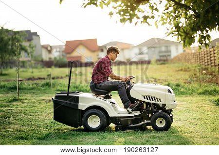 Garnder, Man Worker Cutting Grass With Lawn Mower, Lawncare Concept. Industrial Details