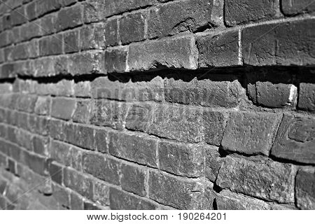 brick wall with focus in the foreground of gray color