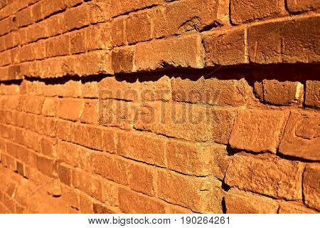 brick wall with focus in the foreground of bright color sepia