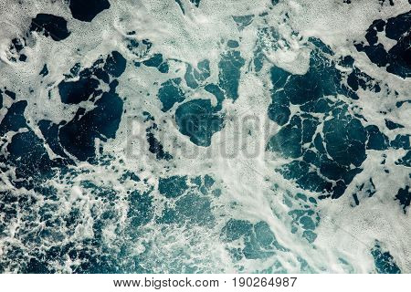 The waves of the Mediterranean sea with white foam