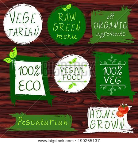 Vintage signs: vegetarian, raw green menu, all organic ingredients, 100 ECO, vegan food, 100 VEG, pescatarian, home grown. VECTOR signs on wooden background