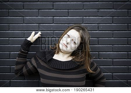 Pale girl in urban black wall anger and serious