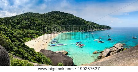 Phuket Thailand - April 21 2017 : panorama view of many people are traveling and speed boats at similan island andaman sea phuket thailand