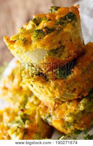 Nourishing Food: Broccoli Muffins With Cheddar Cheese Close-up. Vertical