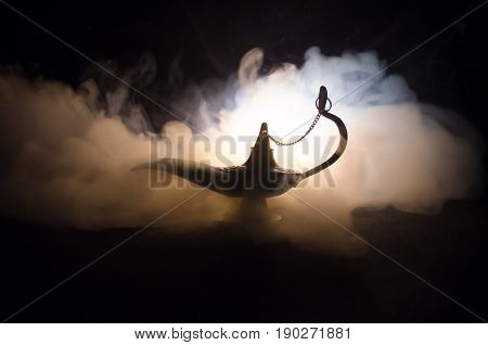 Antique Arabian Nights Style Oil Lamp With Soft Light White Smoke, Dark Background. Lamp Of Wishes C