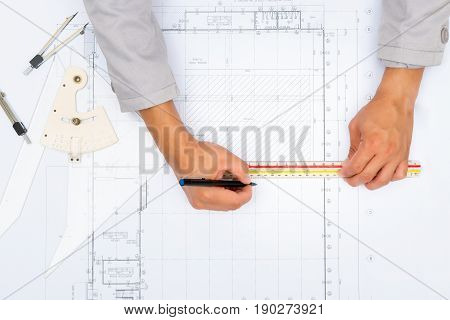 Architect working on blueprint. Architects workplace - architectural project blueprints ruler calculator and divider compass. Construction concept. Engineering tools