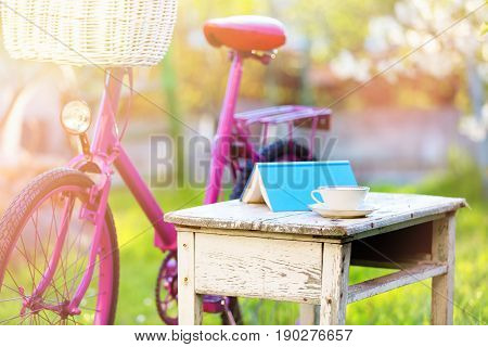 Cup Of Tea, Book And Pink Bike