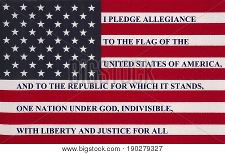The pledge of allegiance written on the United States of America flag