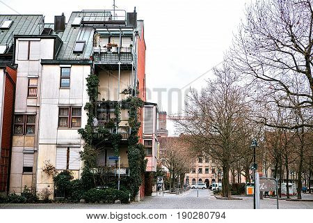 Traditional house in the German style in Bavaria. The architecture of houses in Germany. The house is covered with plants. Furth.