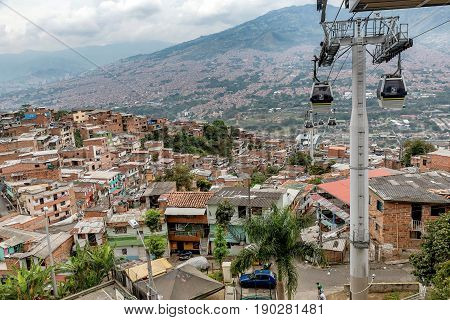Cable cars travel over Medellin slums Colombia