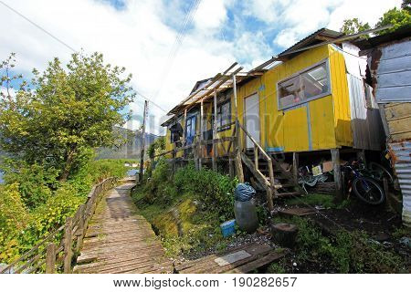 Boardwalk at the isolated Puerto Eden in Wellington Islands, fiords of southern Chile, Province Ultima Esparanza