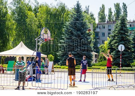 Basketball Players On Basketball Playing Field Before Game Outdoors