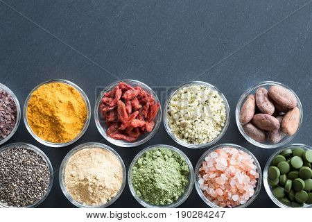 Selection Of Superfoods On A Black Background With Copy Space