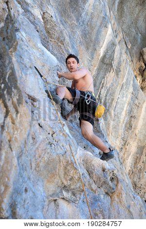 Young Woman Rock Climbing On White Mountain