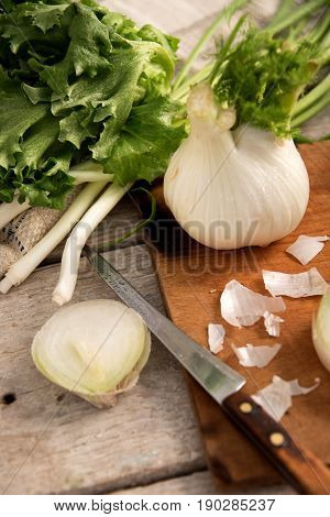 Fennel, White Onion, Lettuce On A Kitchen Table, Rustic Style