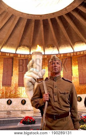 Fighter of Red Army in the form of times of World War II with the machine gun in the Hall of Glory on Mamayev Kurgan