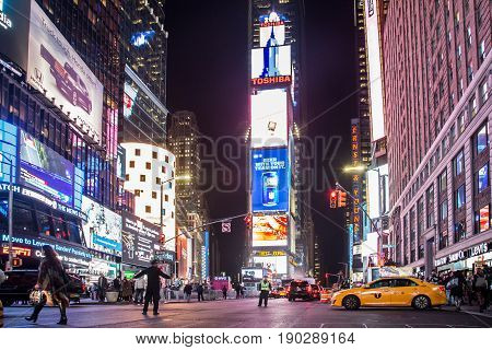 New York, United States of America - November 18, 2016: Famous Times Square at night with illuminated billboards