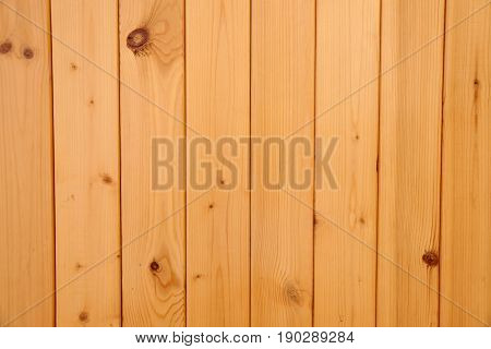 Varnished Wooden facing surface from boards as design element