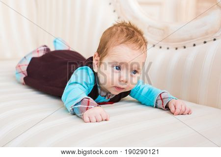 Cute baby boy, closeup portrait of adorable child, sweet toddler with blue eyes, healthy childhood, perfect caucasian infant, lovely kid, innocence concept.