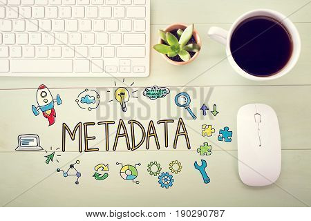 Metadata concept with workstation on a light green wooden desk