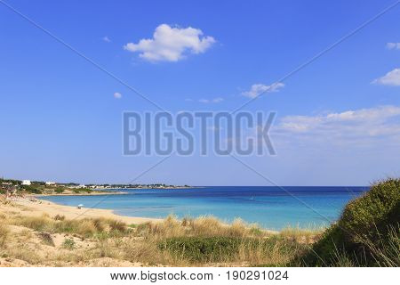 Summer seascape,Apulia coast: Marina di Lizzano beach (Taranto). The coastline is characterized by a alternation of sandy coves and jagged cliffs overlooking a truly clear and crystalline sea.