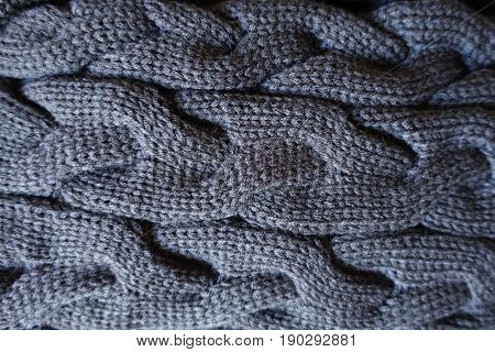 Close Up Of Plait Pattern On Grey Knit Fabric