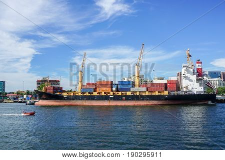 Labuan,Malaysia-May 26,2017:Container ship with full of cargo docked in port of Labuan,Malaysia.The abolishment of cabotage policy is set to benefit this duty-free-island economically.