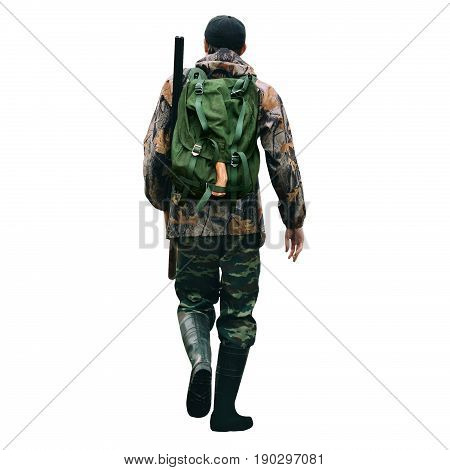 The man is a hunter with a shotgun and backpack. Back view. Man isolated on white background.
