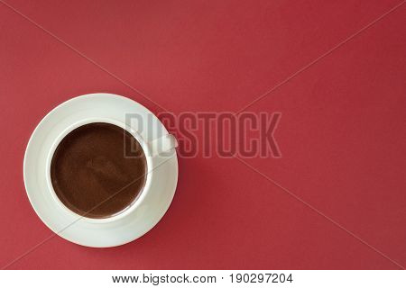 Coffee In White Cup On Red Background.