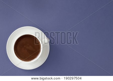 Coffee In White Cup On Blue Background.