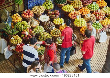 Funchal, Portugal - March 20: People Shopping At The Famous Mercado Dos Lavradores On March 20, 2017