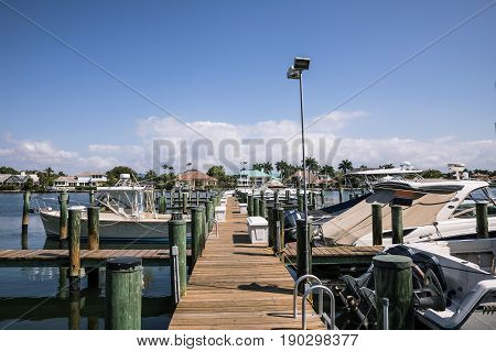 Naples Bay marina in Florida from Tamiami Trail in sunny day. USA. A view toward the entrance of the Naples Dock
