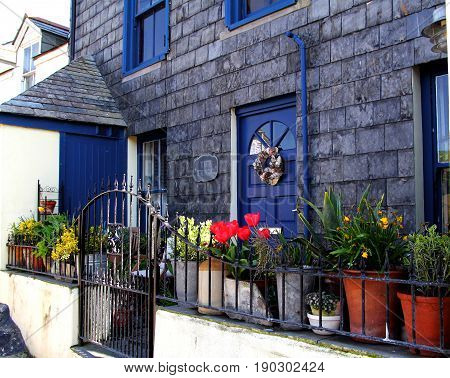 Port Isaac, Cornwall, Uk - April 8Th 2017: A Pretty Display Of Potted Flowers And Other Plants Outsi