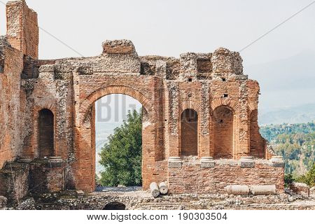 Arched entrance on the ruined Greek theater, Taormina, Sicily, Italy, a well preserved ruin and popular tourist attraction