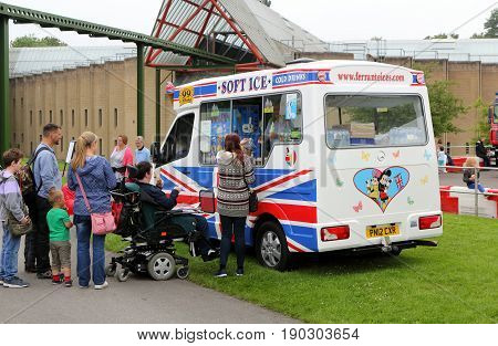 Beaulieu, Hampshire, Uk - May 29 2017: Visitors To The 2017 999 Show Queue For Ice Cream From A Van