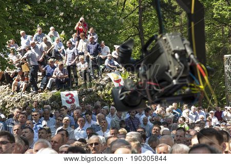 Piekary Sl Poland May 28 2017: A TV camera on a jib over a crowd of men gathered at a men's clinic in Piekary Slaskie in Poland