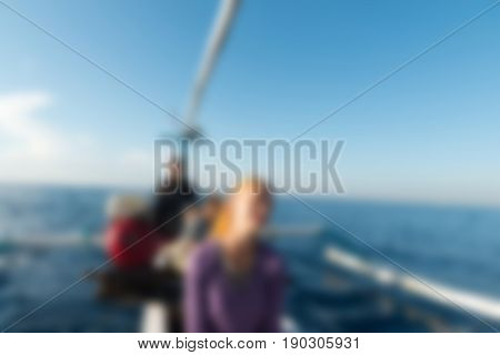 Dolphin watching Bali Indonesia Travel theme creative abstract blur background with bokeh effect