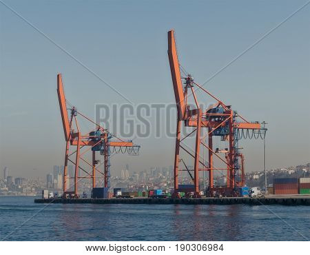 Day shot of the cranes in the shipyard of the Port of Haydarpasha Istanbul Turkey with city view in the background