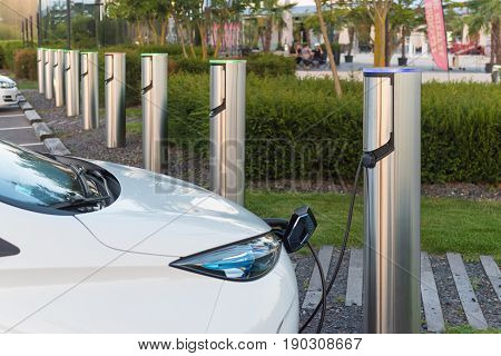 METZ FRANCE - AUGUST 12 2016: Renault electric car plugged in at a charging point