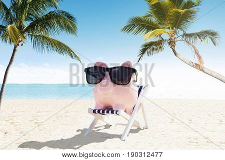 Piggybank With Sunglasses On Deck Chair Enjoying The Holiday At Beach