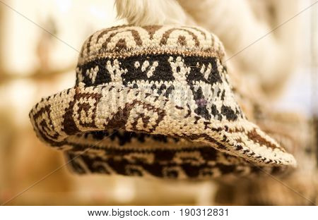 OTAVALO, ECUADOR - MAY 17, 2017: Beautiful andean traditional hat textile yarn and woven by hand in wool, in blurred background.