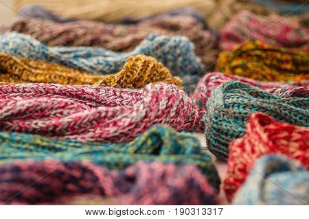 OTAVALO, ECUADOR - MAY 17, 2017: Beautiful andean traditional scarf clothing textile yarn and woven by hand in wool, colorful fabrics background.