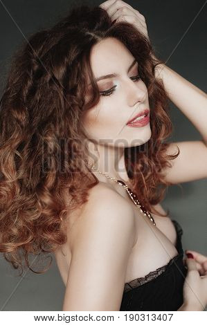Beautiful Curly Red-haired Young Woman In A Black Corset.