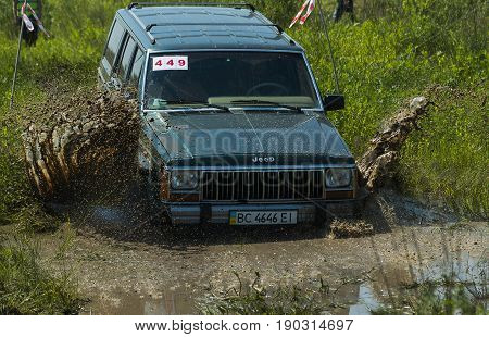 Lviv Ukraine - May 30 2015: Off-road vehicle Jeep Cherokee (No 449) overcomes the track on of landfill near the city Lviv.