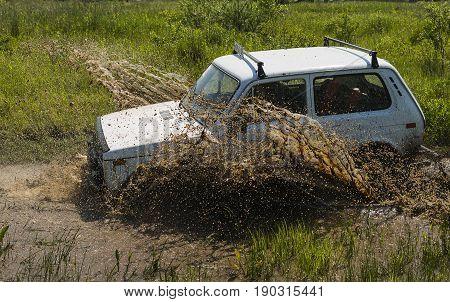 Lviv Ukraine - May 30 2015: Off-road vehicle NIVA overcomes the track on of landfill near the city Lviv.