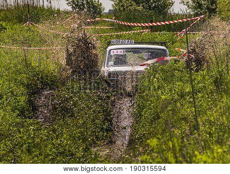 Lviv Ukraine - May 30 2015: Off-road vehicle VAZ-NIVA (No. 333) overcomes the track on of landfill near the city Lviv.