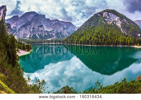 Beautiful lake Lago di Braies, South Tyrol, Italy. The concept of walking and eco-tourism. Green expanse of water