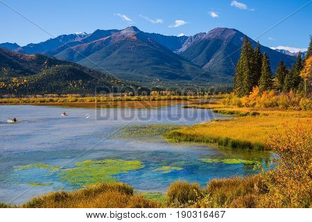 Autumn forest, mountains and lakes. Beautiful Lake Vermilion in the mountains of Banff National Park. The Canadian province of Alberta. Concept of active tourism